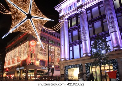London, UK - November 10, 2011: The Christmas lights decorations outside Marks & Spencer and Selfridges at night, in Oxford Street during the festive season