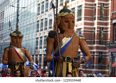 London, UK. - November 10, 2018: Willow representations of Gog and Magog, the symbolic protectors of the City of London, paraded during the 2018 Lord Mayors Show.