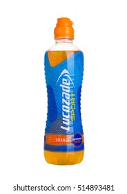 LONDON, UK - NOVEMBER 11, 2016: Cold bottle of Lucozade Sport energy drink with orange flavour on white background isolated