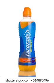LONDON, UK - NOVEMBER 11, 2016: Cold bottle of Lucozade Sport energy drink with orange flavour on white background with reflection