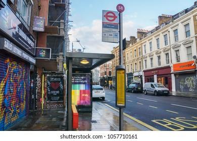 London / UK - November 12 2017: bus stop at Brick Lane with vintage building backdrop