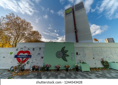 London, UK November 13, 2018: A view of polythene wrapped Grenfell Tower and memorials, while forensic investigations take place after the fire