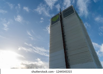 London, UK November 13, 2018: A view of polythene wrapped Grenfell Tower against blue sky, while forensic investigations take place after the fire