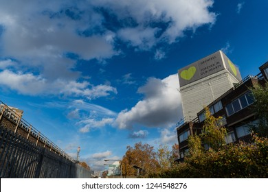 London, UK November 13, 2018: A view of polythene wrapped Grenfell Tower and surrounding buildings, while forensic investigations take place after the fire
