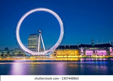 LONDON UK - NOVEMBER 14TH 2015; The Millennium eye and county hall on the South Bank of London illuminated at dusk