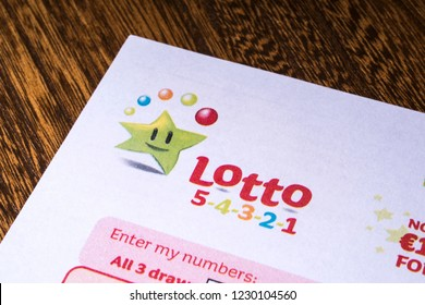 London, UK - November 14th 2018: A close-up of the Irish National Lottery logo, pictured on a Lotto 5-4-3-2-1 lottery sheet.