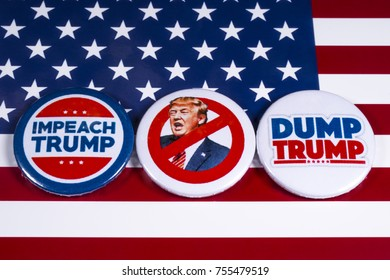 LONDON, UK - NOVEMBER 15TH 2017: Anti-Tump badges over an American flag background, on 15th November 2017.