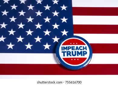 LONDON, UK - NOVEMBER 15TH 2017: Anti-Tump badge over an American flag background, on 15th November 2017.