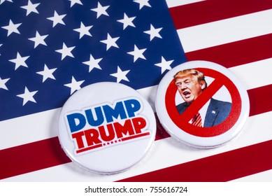 LONDON, UK - NOVEMBER 15TH 2017: Anti-Tump badges over an American flag background, on 15th November 2017.