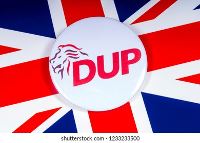 London, UK - November 15th 2018: A Democratic Unionist Party pin badge, pictured over the UK flag.