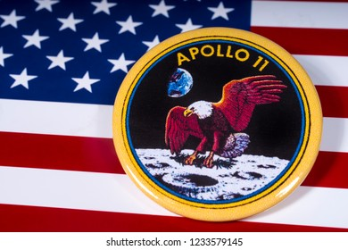 London, UK - November 15th 2018: The badge of the historic Apollo 11 moon landing, pictured over the flag of the United States of America.