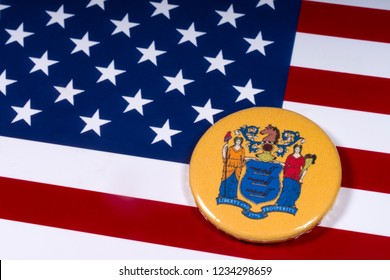 London, UK - November 15th 2018: The coat of arms of the State of New Jersey, pictured over the flag of the United States of America.