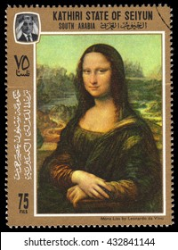 London, UK, November 16 2010 - Vintage 1967 Kathiri State Of Seiyun cancelled postage stamp  showing a portrait image of the smiling Mona Lisa