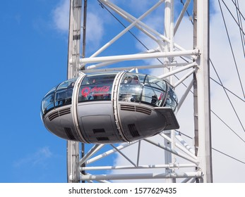 London, UK - November 16, 2019 : View of the London Eye and passengers in capsule. London Eye (135 m tall, diameter of 120 m) is a cantilevered observation wheel, famous tourist attraction in London.
