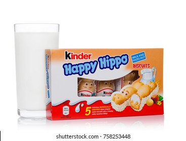 LONDON, UK - November 17, 2017: Kinder chocolate happy hippo and milk glass on white background.Kinder bars are produced by Ferrero founded in 1946.