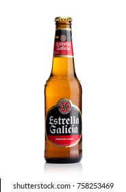 LONDON, UK - November 17, 2017: Bottle of Estrella Galicia pale lager draft beer on white background. Estrella Galicia is produced by Hijos de Rivera Brewery in La Coruna,Spain since 1906.