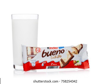 LONDON, UK - November 17, 2017: Kinder chocolate bueno and milk glass on white background.Kinder bars are produced by Ferrero founded in 1946.