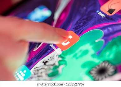 LONDON, UK - NOVEMBER 17, 2018: Shutterstock app icon being launched, Close up macro of a woman finger about to touch app icon on latest Apple iPad Pro release