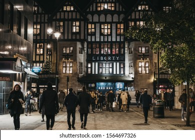 London, UK - November 17, 2019:Face of Liberty Department Store in Oxford Circus, London, in the evening,people walk in front. Opened in 1875 it is famous for luxury goods and classic Liberty designs.