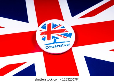 London, UK - November 18th 2018: A Conservative Party pin badge over the UK flag.