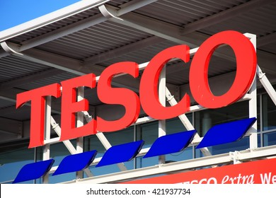 London, UK â?? November 19, 2011:  Tesco logo advertising sign outside its retail supermarket stores in Brent Park Wembley