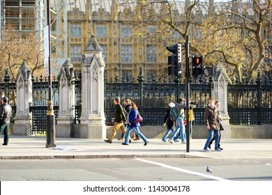 LONDON, UK - NOVEMBER 19, 2017: Lots of tourists and Londoners walking down the streets and crossing the junctions. Beautiful sunny autumn day in the capital of Great Britain.