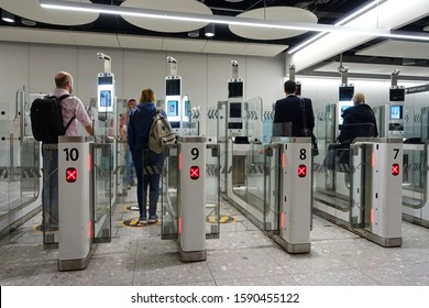 London, UK - November 19, 2019: Air travellers pass through automated passport border control gates at Heathrow Airport. Heathrow and UK Border Force use facial recognition technology.