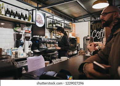 London, UK - November 2, 2018: People at Cafe Latino stand in Mercato Metropolitano, the first sustainable community market in London focused on revitalising the area and protecting environment.