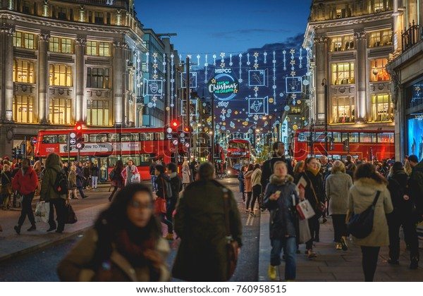 London, UK - November 2017. Decorated Oxford Circus crowded with people shopping for Christmas.