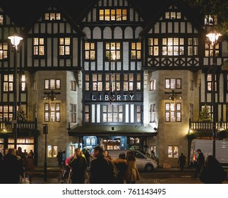 London, UK - November 2017. People walking in front of Liberty high class department store in Soho at night during the Christmas season.