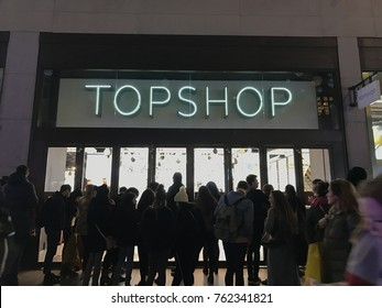 LONDON, UK - NOVEMBER 2017 - People are waiting outside TOPSHOP Oxford Street after the shop temporary closed for Oxford Circus Tube station incident on Black Friday 24th November 2017 in London.