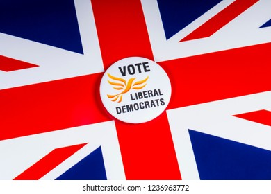 London, UK - November 20th 2018: A Liberal Democrats political party badge, pictured over the flag of the United Kingdom.