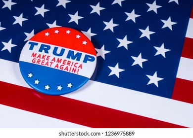 London, UK - November 20th 2018: Trump - Make America Great Again! pin badge, pictured over the flag of the United States of America.