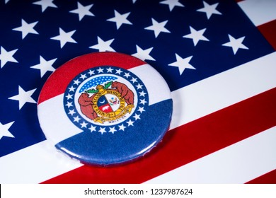 London, UK - November 20th 2018: The symbol of the State of Missouri, pictured over the flag of the United States of America.