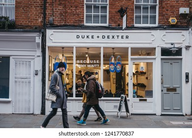 London, UK - November 21, 2018: People walking past Duke + Dexter shop in Covent Garden, London, UK. Covent Garden is a famous tourist area in London with lots of shops and restaurants.