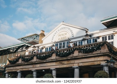 London, UK - November 21, 2018: People on the balcony of Punch & Judy pub in Covent Garden Market, one of the most popular tourist sites in London, UK.