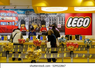 London, UK - November 22, 2016 - Customers queuing to check out in the world's largest LEGO store, newly opened in Leicester Square