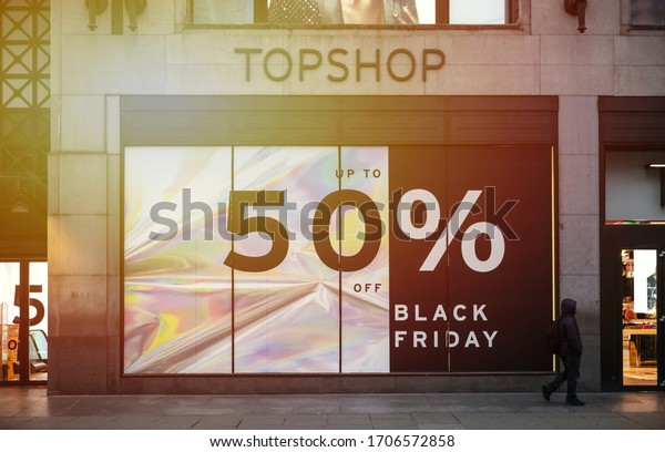 London / UK - November 22, 2018: a Black Friday sale poster covering a window of a fashion retailer