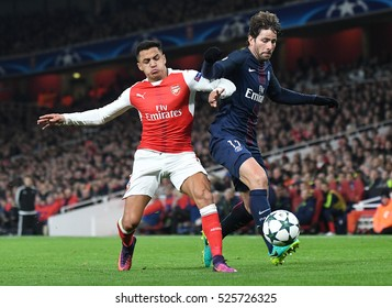 LONDON, UK - NOVEMBER 23, 2016: Alexis Sanchez of Arsenal and Maxwell of PSG pictured during the UEFA Champions League Group A game between Arsenal FC and Paris Saint Germain on Emirates Stadium.