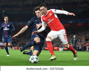 LONDON, UK - NOVEMBER 23, 2016:Thomas Meunier and Mesut Ozil pictured during the UEFA Champions League Group A game between Arsenal FC and Paris Saint Germain on Emirates Stadium.