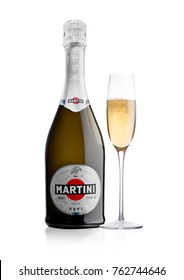 LONDON, UK - November 24, 2017: Bottle and glass of sparkling wine Martini Asti on white background. Produced in Italy