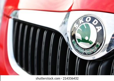 LONDON, UK - NOVEMBER 28, 2010: Detail of Skoda logo on red car.