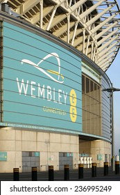 LONDON, UK - NOVEMBER 28, 2014: A detail of the exterior facade of the new Wembley stadium with a billboard on November 28, 2014 in London / Wembley Stadium