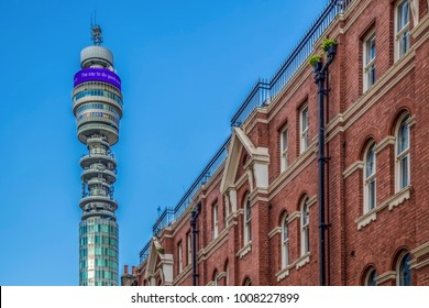 LONDON, UK - NOVEMBER 28, 2017: Old and new together. Victorian architecture at old buildings and BT Tower-Post Office Tower with 189 metres high, designed by architects Eric Bedford and G. R. Yeates.