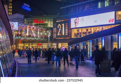 LONDON, UK - NOVEMBER 29, 2014: Stratford village square and big shopping centre decorated with Christmas lights and lots of people shopping around