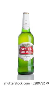LONDON, UK -NOVEMBER 29. 2016  Cold Bottle of Stella Artois beer on white background, prominent brand of Anheuser-Busch InBev, is a pilsner brewed in Leuven, Belgium, since 1926