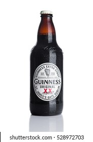 LONDON, UK - NOVEMBER 29, 2016: Guinness extra stout beer  bottle on white background. Guinness beer has been produced since 1759 in Dublin, Ireland.
