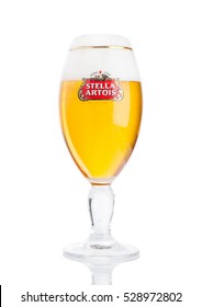LONDON, UK -NOVEMBER 29. 2016  Cold glass of Stella Artois beer on white background, prominent brand of Anheuser-Busch InBev, is a pilsner brewed in Leuven, Belgium, since 1926