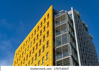 LONDON, UK - November 3, 2019: The top of the yellow building in the Central St Giles complex, designed by Italian architect Renzo Piano, in Central London