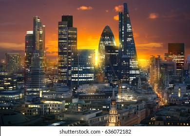 London, UK - November 30, 2016:  Multiple exposure image City of London, business and banking aria at sunset